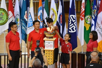 (From left) Tony Low, chairman of Singapore School Sports Council; Education Minister Ong Ye Kung; Zikos Chua (football) from Nanyang JC; Adelina Cheok (rope skipping) from Edgefield Primary; Singapore Primary School Sports Council chairman Lee Hui Feng light the cauldron during the National School Games opening ceremony at the OCBC Arena on Jan 21, 2020.ST PHOTO: CHONG JUN LIANG